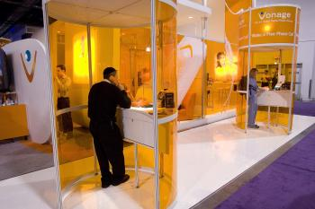 The photo shows the Vonage booth at the 2008 International Consumer Electronics Show. Vonage Holdings Inc. announced a $55 million loss for Q3 2009, attributing it to a strange accounting error caused by a rise in stock prices earlier in the quarter. (David Paul Morris/Getty Images)