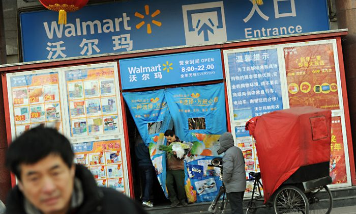 Chinese shoppers leave a Walmart store in Beijing in January. Wal-Mart's years long sustainability program has fallen flat on many promises in light of accountability issues with Chinese suppliers. (Mark Ralston/Getty Images)