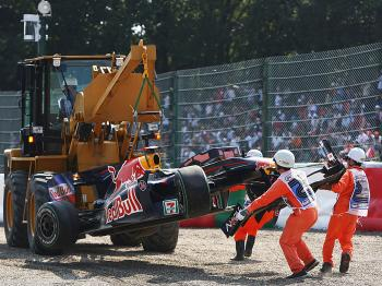 Mark Webber's Red Bull is hoisted off the track after Webber crashed in Saturday morning practice. (Vladimir Rys/Bongarts/Getty Images)