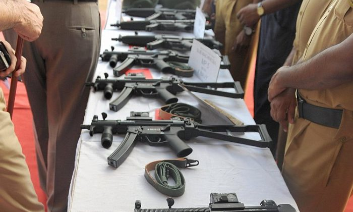 Indian policemen inspect various imported automatic weapons on display during a function to review the counterterrorism set up in Mumbai on Aug. 27, 2009. (Indranil Mukherjee/AFP/Getty Images)