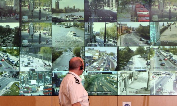 A police officer watches monitors showing a fraction of London's CCTV camera network in the Metropolitan Police's Special Operations Room on April 20, 2007 in London, England. The U.K. is set to give one of its intelligence agencies the right to survey communications without warrants. (Matt Cardy/Getty Images)