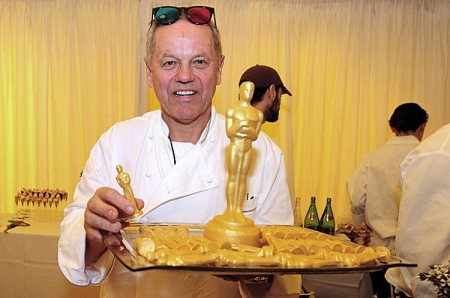 Celebrity chef Wolfgang Puck poses with a tray of Gold chocolate Oscars as chefs continue with preparations during a media preview on February 23, 2012 in Hollywood of food and beverages to be served at the Governor's Ball immediately following the 84th Annual Academy Awards on Sunday, Feb. 26. (Frederic J. Brown/AFP/Getty Images)
