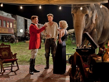 LOVE QUADRILATERAL: Christoph Waltz, Robert Pattinson, Reese Witherspoon, and Rosie the elephant in a scene from the film Water for Elephants. (David James/Twentieth Century Fox Film Corp.)