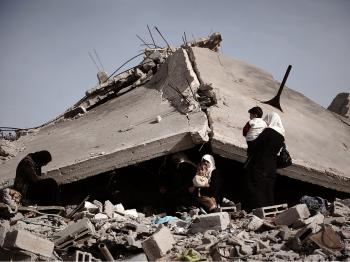 A Palestinian family sits on the rubble of their destroyed house following Israel's 22-day offensive in Gaza on January, in the northern Gaza Strip district of Jabalia.   (Olivier Laban-Mattei/AFP/Getty Images)