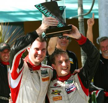 Leh Keen and Dirk Werner celebrate winning the 2009 Grand Am Rolex GT championship. (James Fish/The Epoch Times)