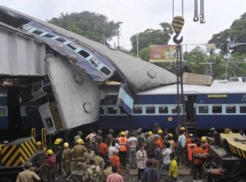 West Bengal Train Crash: Indian rescue personnel conduct recovery operations on the mangled wreckage of train coaches following a railway accident in Sainthia, some 260 kms north of from Kolkata, on July 19. (Deshakalyan Chowdhury/AFP/Getty Images)