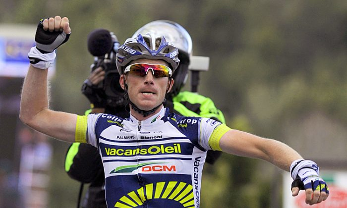 Vacansoleil's Lieuwe Westra punches the air with pride as he crosses the line to win Stage Five of the Paris-Nice cycling race. (Pascal Pavani/AFP/Getty Images)