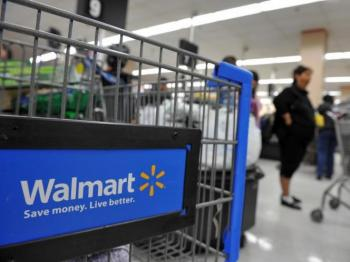 The world's largest retailer Wal-Mart Stores Inc. has announced that it will end profit-sharing contributions that have been automatically distributed since 1971. (Robyn Beck/AFP/Getty Images)