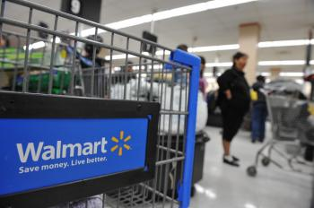 """Wal-Mart Stores Inc. has begun experimenting with online deliveries of groceries in San Jose, Calif. The service, called """"Walmart To Go,"""" allows consumers to purchase groceries online and have them delivered to their homes.  (Robyn Beck/AFP/Getty Images)"""