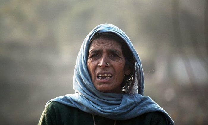 A woman on the mountainous borders of the Northern Indian state of Jammu and Kashmir. (Venus Upadhayaya/The Epoch Times)