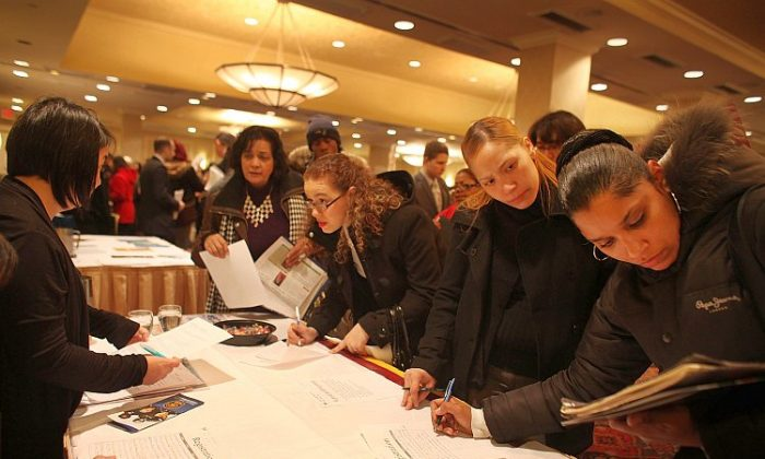 Young job seekers attend a career fair in Midtown Manhattan last month. According to a report by the Economic Policies Institute, entry-level wages have declined steadily for young workers over the last decade. (Spencer Platt/Getty Images)