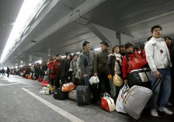 A throng of farm workers goes to Guangdong Province looking for jobs. This photo was taken on Feb. 4, 2009 at the Guangzhou Train Station. (Liu Jin/AFP/Getty Images)