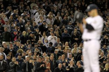 Fans cheer as Andy Pettitte #46 of the New York Yankees pitches against of the Los Angeles Angels of Anaheim in the top of the sixth inning of Game Six of the ALCS. (Al Bello/Getty Images)
