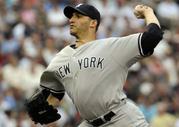 Pitcher Andy Pettitte won the second of two games for New York against the Minnesota Twins on Wednesday. (Hannah Foslien / Getty Images)