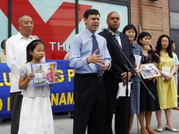 Councilmember David Yassky and Assemblymember Karim Camara join Falun Gong practitioners whose family members are missing in China in protesting the Chinese regime's support of the Sudan genocide and its persecution of Falun Gong. (Edward Dai The Epoch Times)