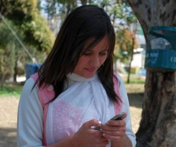 A 21-year-old university student texting during a break in her schedule. (The Epoch Times)