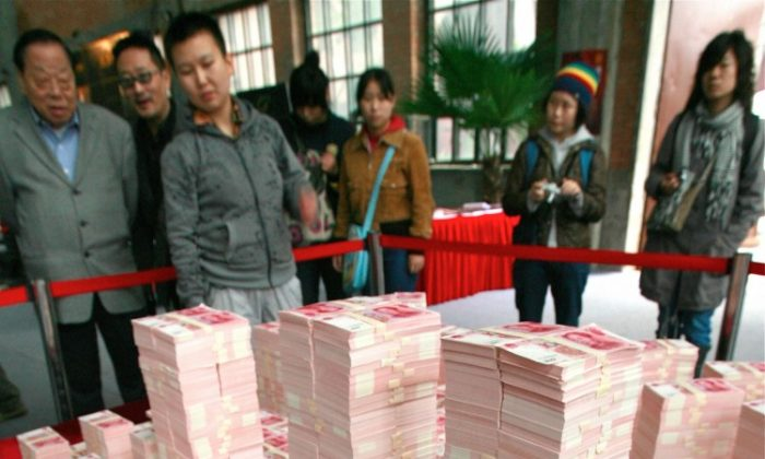 Beijing's Central Business District made from Chinese yuan notes, in 2007. Economists say that the excessive printing of money in China has led to inflation, which the regime attempts to conceal. (Teh Eng Koon/AFP/Getty Images)