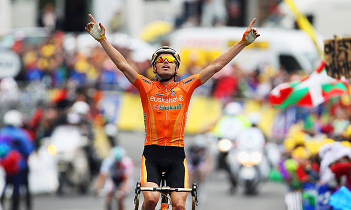 Samuel Sanchez, here winning Stage Twelve of the 2011 Tour de France, took the stage win and race lead in Stage Three of the 2012 Tour of the Basque Country. (Bryn Lennon/Getty Images)