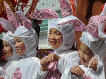 YEAR OF THE RABBIT: Children take part in an early Chinese New Year performance at a shopping mall in Hong Kong on Jan. 25. 2011 marks the coming Year of the Rabbit according to the Chinese Lunar Calendar. (Mike Clarke/AFP/Getty Images)