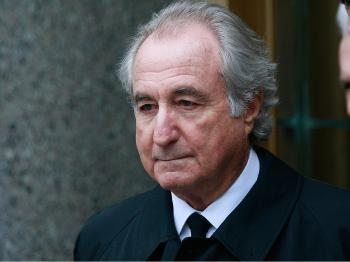 Accused $50 billion Ponzi scheme swindler Bernard Madoff exits federal court in New York City. Madoff was attending a hearing on his legal representation and is due back in court Thursday.  (Mario Tama/Getty Images)