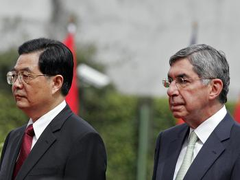 The President of Costa Rica Oscar Arias (R) and his guest, President Hu Jintao of China, listen to their national anthems during a welcoming ceremony at the presidential palace in Zapote, on the outskirts of San Jose, on November 17, 2008.   (Mayela Lopez/AFP/Getty Images)