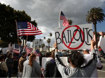 Demonstrators gather at an American Family Association (AFA)-sponsored T.E.A. (Taxed Enough Already) Party to protest taxes and economic stimulus spending, April 15, 2009 in Santa Monica, California.   (David McNew/Getty Images)