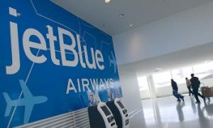 JetBlue Flight Attendant Escapes Argument Through Emergency Exit