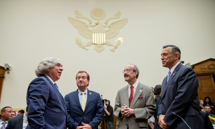 From left, Secretary of Energy Ernest Moniz, Chairman Rep. Ed Royce, R-Calif., Ranking Member Rep. Eliot Engel, and Rep. Darrell Issa, R-Calif. speak together before a House Foreign Affairs Committee hearing in Washington, Tuesday, July 28, 2015, on the Obama administration's case for the Iran Nuclear Agreement. (AP Photo/Andrew Harnik)