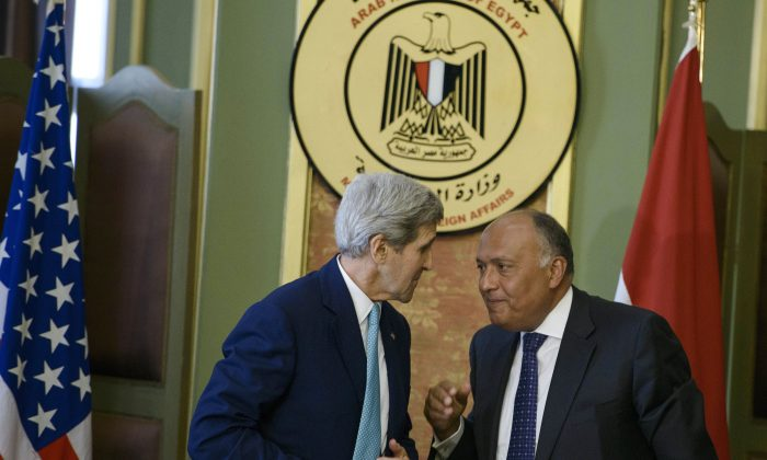 Secretary of State John Kerry (L) and Egypt's Foreign Minister Sameh Shoukry at a press conference after their meeting at the foreign ministry in Cairo, Egypt, on Sunday, Aug. 2, 2015. (Brendan Smialowski/Pool Photo via AP)