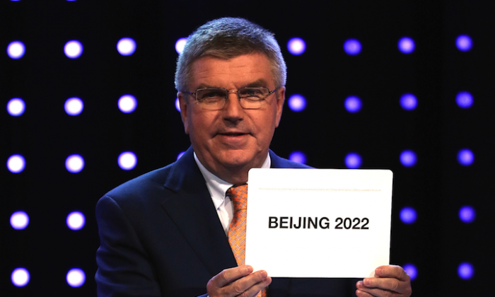 The International Olympic Committee president Thomas Bach announces Beijing, China as the host city for the 2022 Winter Olympics during the Announcement Ceremony on July 31, 2015 in Kuala Lumpur, Malaysia. (How Foo Yeen/Getty Images)