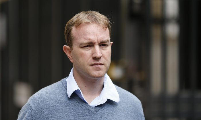 Tom Hayes arrives at Southwark Crown Court in London, Thursday, July 30, 2015, where he denies charges of conspiracy to defraud. (AP Photo/Frank Augstein)