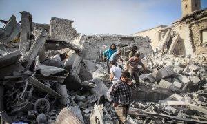 Activists: Syria Warplane Crashes, Killing and Wounding Many