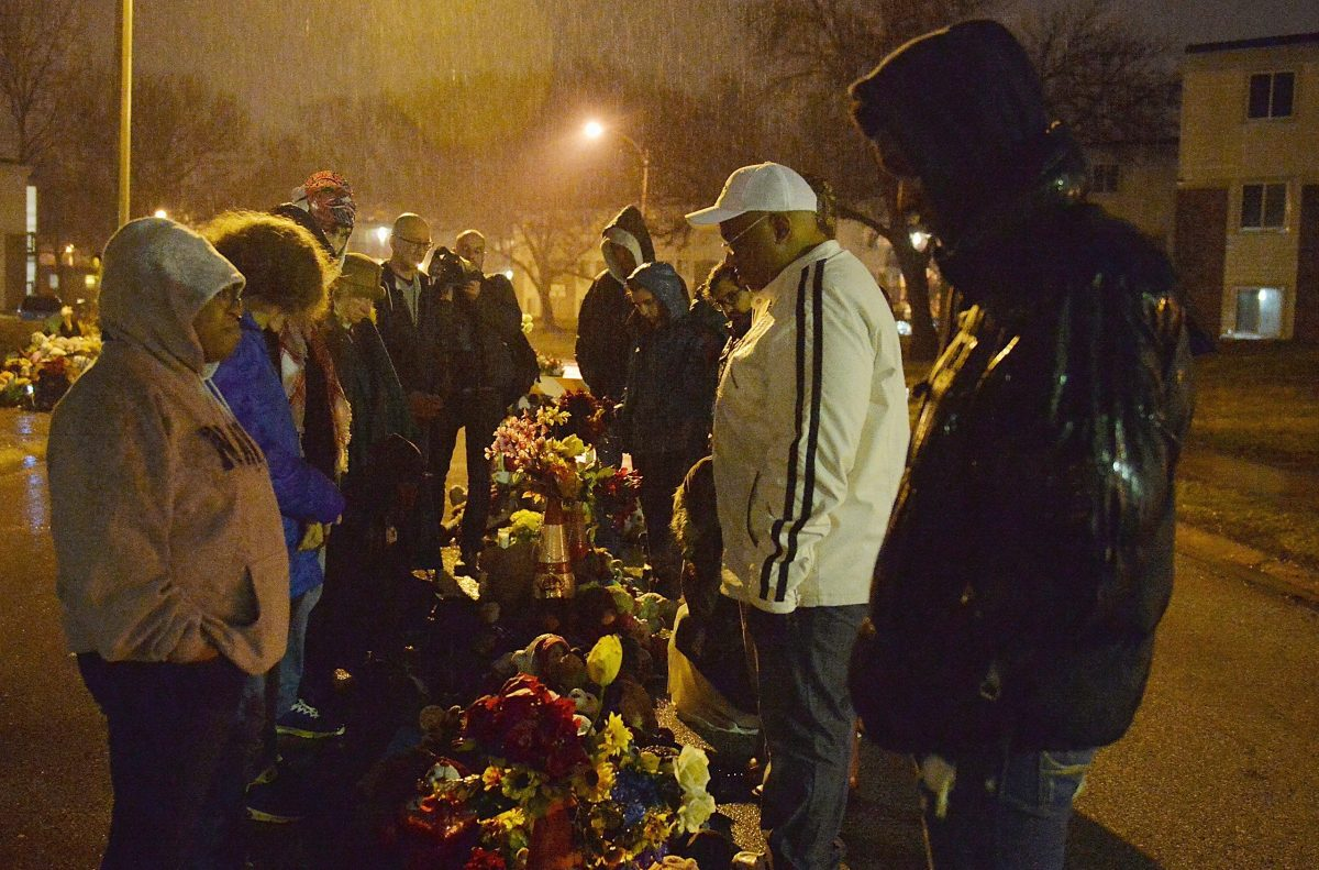 A group of protesters gather at the memorial for Michael Brown Jr. at Canfield Apartments in Ferguson, Mo., on March 13, 2015. (Michael B. Thomas/AFP/Getty Images)