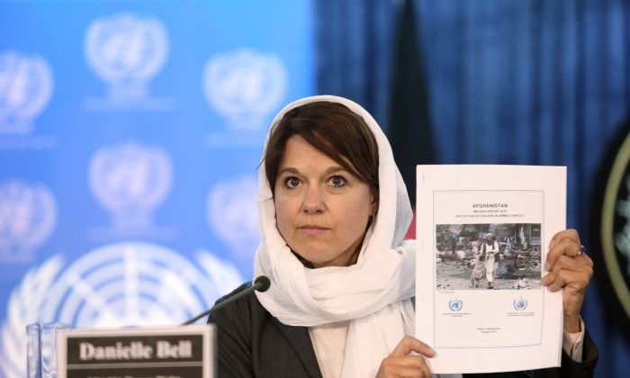 Danielle Bell, United Nations Assistance Mission in Afghanistan, UNAMA, Human Rights Director shows a copy of the United Nations casualty report during a press conference in Kabul, Afghanistan, Wednesday, Aug. 5, 2015. (AP Photo/Rahmat Gul)
