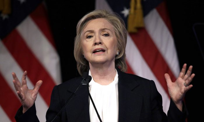 In this July 13, 2015, file photo, Democratic presidential candidate Hillary Rodham Clinton speaks at a campaign event in New York.  Federal officials say two government inspectors general have asked the Justice Department to determine whether sensitive government information was transmitted on Hillary Rodham Clinton's personal email.  (AP Photo/Seth Wenig)