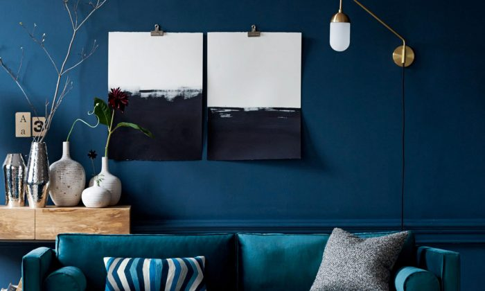 This photo provided by West Elm shows a trim midcentury sofa that is available in one of this fall's trending shades of deep blue. (West Elm via AP)