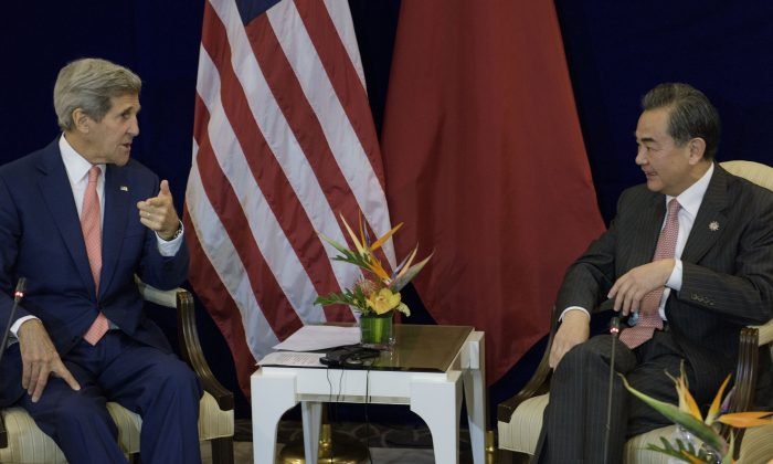 U.S. Secretary of State John Kerry (L) and China's Foreign Minister Wang Yi before a bilateral meeting at the Putra World Trade Center in Kuala Lumpur, Malaysia, on Wednesday, Aug. 5, 2015. (Brendan Smialowski/AFP/Getty Images)