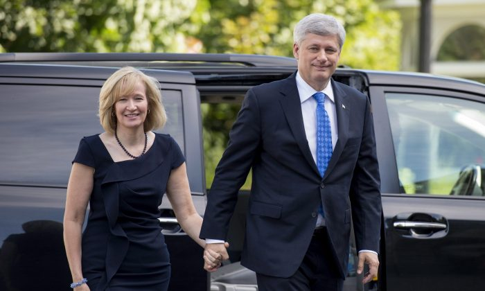 Prime Minister Stephen Harper visits Governor General David Johnston, along with his wife Laureen, to dissolve parliament and trigger an election campaign at Rideau Hall on Aug. 2, 2015. (The Canadian Press/Justin Tang)