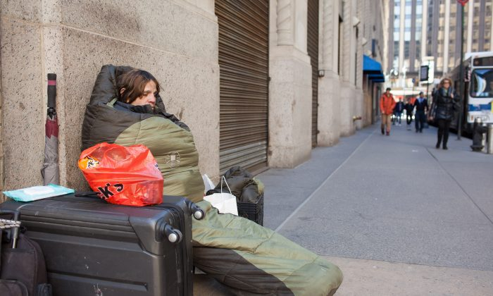 Denise Cruz, 43, a homeless woman, on the street in Midtown Manhattan on March 29, 2015. (Petr Svab/Epoch Times)