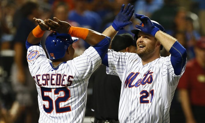 Mets sluggers (L) Lucas Duda and the newly-acquired Yoenis Cespedes have helped New York climb into first place in the NL East. (Rich Schultz/Getty Images)