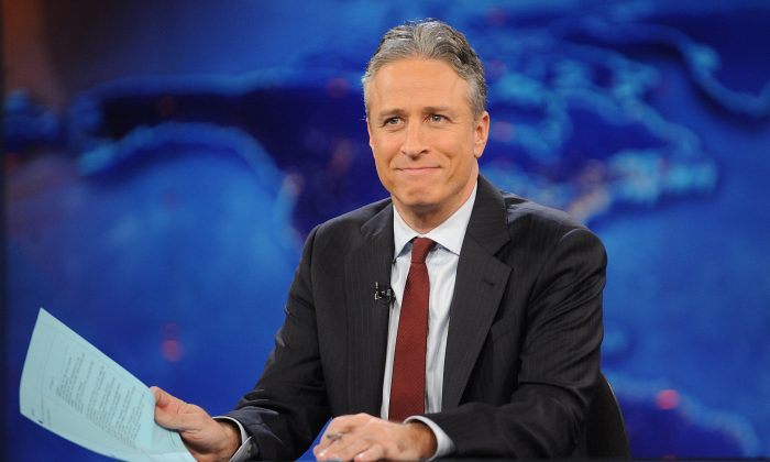 "FILE - This Nov. 30, 2011 file photo shows television host Jon Stewart during a taping of ""The Daily Show with Jon Stewart"" in New York. (AP Photo/Brad Barket, File)"
