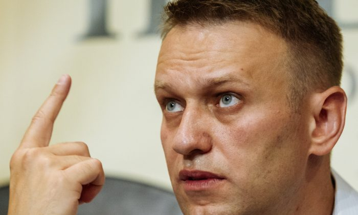 Russian opposition activist and blogger Alexei Navalny gestures while speaking to the media during his visit in Novosibirsk, Russia, Sunday, June 7, 2015. Navalny in his first public event outside of Moscow for three years is in town to urge voters to participate in upcoming primaries that will choose opposition candidates for regional elections, in Novosibirsk as well as in other major Russian cities. (AP Photo/Alexander Lukin)
