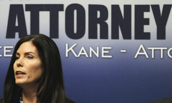 In this Feb. 13, 2015, file photo, Pennsylvania Attorney General Kathleen G. Kane speaks during a news conference in Scranton, Pa. Kane, the first woman and first Democrat elected attorney general in Pennsylvania, was charged Thursday, Aug. 6, 2015, with perjury, obstruction, abuse of office, conspiracy and false swearing.  (Butch Comegys/The Times Tribune via AP)