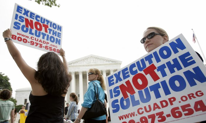 Anti death penalty activists rally outside the U.S. Supreme Court June 29, 2005 in Washington, DC. The group rallied during their 12th annual vigil and fast they call 'Starvin for Justice 2005' held from June 28-July 2. (Photo by Brendan Smialowski/Getty Images)