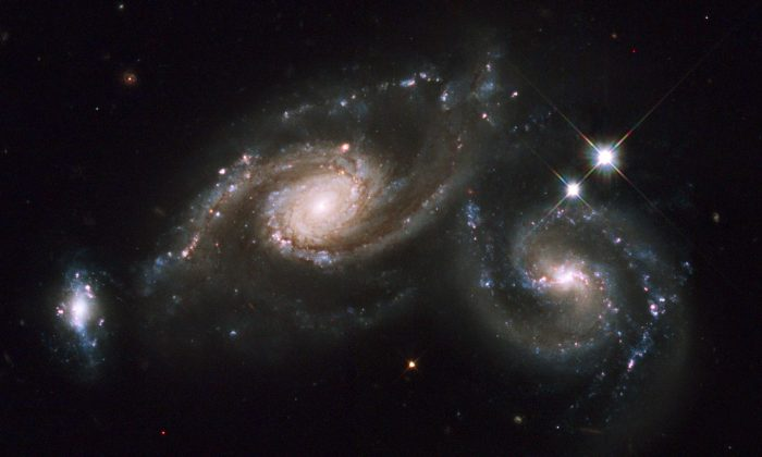 """Theoretically we thought that when the universe was only 5 percent of its present age, it would be a place full of chaos and disorder,"" Rupert Croft says. ""Our simulation showed that the early universe might be far from being just this. It might contain beautiful symmetrical galaxies, like the Milky Way."" (Hubble Heritage/CC BY-SA 2.0)"