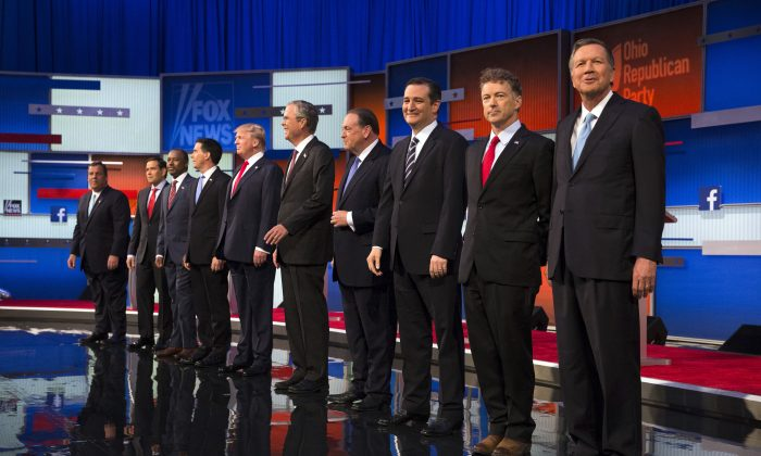 Republican presidential candidates (L-R) Chris Christie, Marco Rubio, Ben Carson, Scott Walker, Donald Trump, Jeb Bush, Mike Huckabee, Ted Cruz, Rand Paul, and John Kasich take the stage for the first Republican presidential debate at the Quicken Loans Arena in Cleveland on Thursday, Aug. 6, 2015. (AP Photo/John Minchillo)