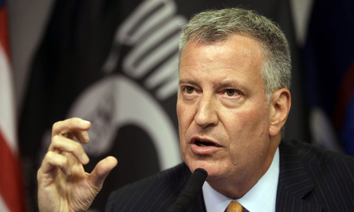 New York City Mayor Bill de Blasio during a news conference to provide an update of the Legionnaires' disease outbreak, in New York on Saturday, Aug. 8, 2015. (AP Photo/Mary Altaffer)