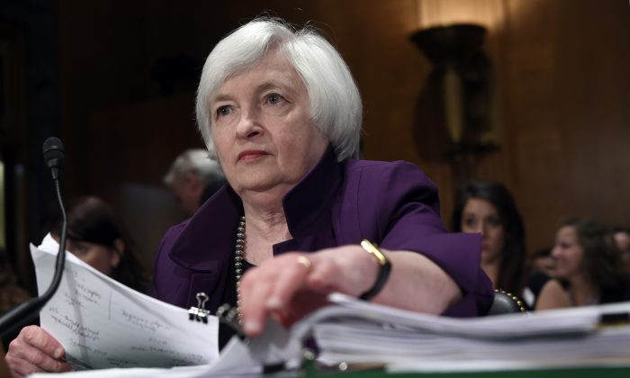 FILE - In this July 16, 2015, file photo, Federal Reserve Chair Janet Yellen prepares to testify before the Senate Banking Committee on Capitol Hill in Washington. (AP Photo/Susan Walsh, File)
