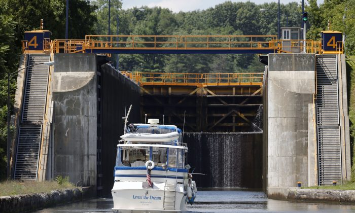 In this Tuesday, Aug. 4, 2015 photo, a boat enters Lock 4 of the Erie Canal in Waterford, N.Y. (AP Photo/Mike Groll)