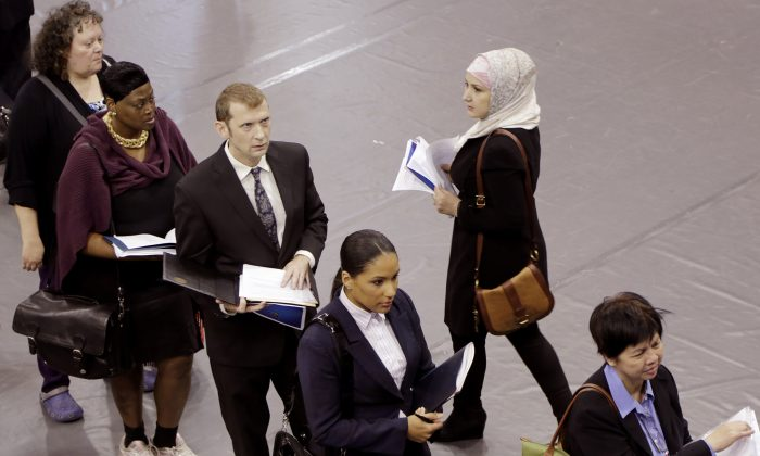 Job hunters line up for interviews at an employment fair sponsored by the New York State Department of Labor in Brooklyn, New York, on Oct. 8, 2014. (Mark Lennihan/AP Photo)